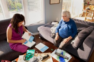 A Care Coordinator visits a patient at home