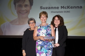 Suzanne McKenna poses after receiving an award