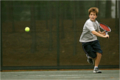 A boy plays tennis