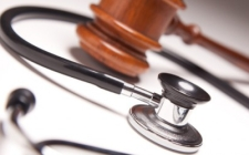 Photo of a stethoscope and a gavel