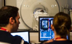 Physicians study an MRI scan