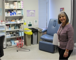 A nurse stands in a nursing clinic room